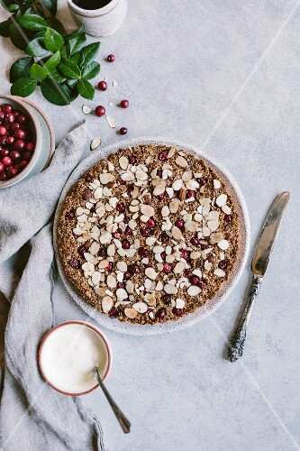 A cranberry almond tart with creme fraiche and fresh cranberries