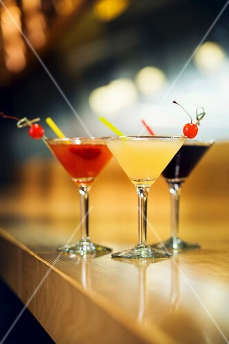 Three Alcoholic Beverages on a Bar