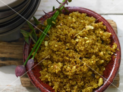 Fried quinoa with curry and almonds