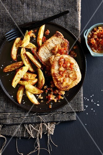 Pork minute steaks with pear and pepper chutney and potato wedges