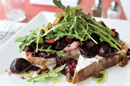 Beet and arugula Bruschetta with chive goat cheese spread