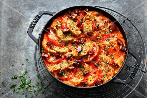 Spicy, oven-baked bread stew with tomatoes and chorizo