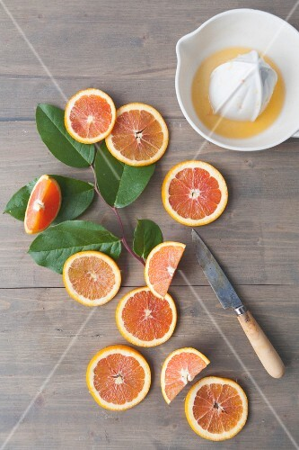 Oranges with a citrus press