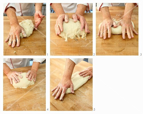 Dough being kneaded by hand