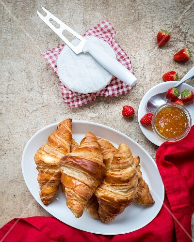 Croissants, strawberries, marmelade and brie