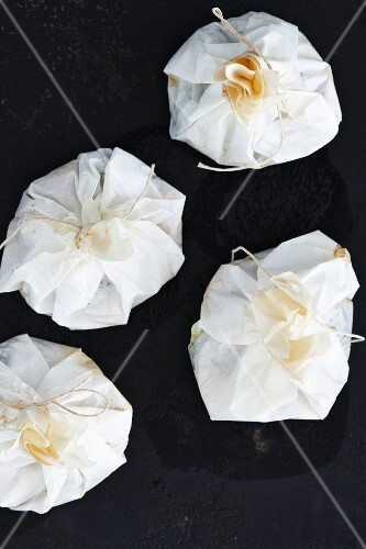 Tied parchment paper packets