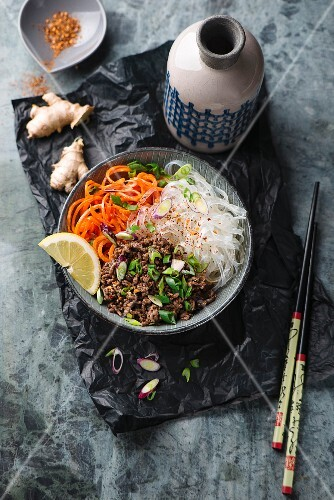 Asian rice noodles with beef chop and carrot salad