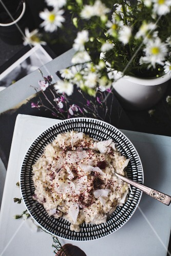 Overnight oats or bircher muesli with coconut and cranberries (Seen from above)