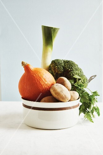 Ingredients for vegetable stew in a porcelain bowl