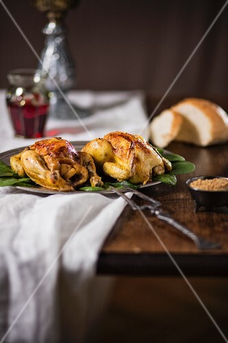 Stuffed roast chicken on a wooden table in a restaurant