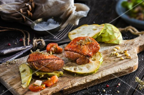 Marinated duck breast on cherimoya slices