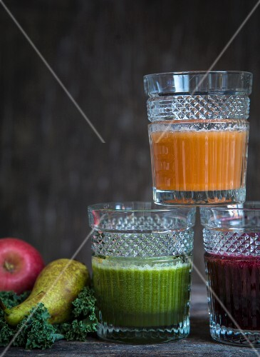 Carrot juice, green cabbage juice and blueberry juice