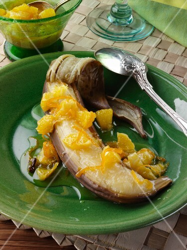 A grilled banana with carmelised orange sauce