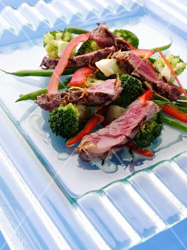 Griddled sirloin steak strips and vegetable salad