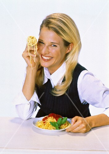 Woman Holding Fork with Twirled Spaghetti
