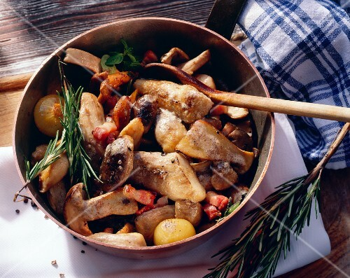 Sauteed Mushrooms in a Pan with Ham and Onions; Rosemary