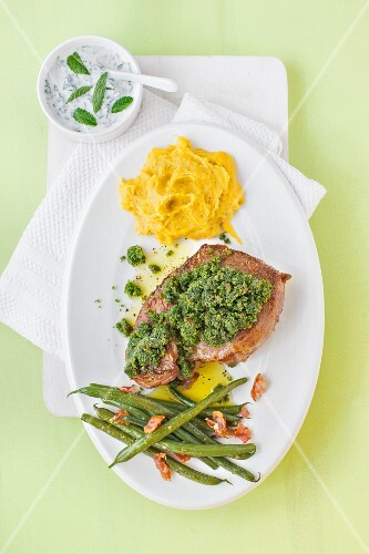 Leg of lamb with a herbed crust, dip, carrot and potato mash and green beans