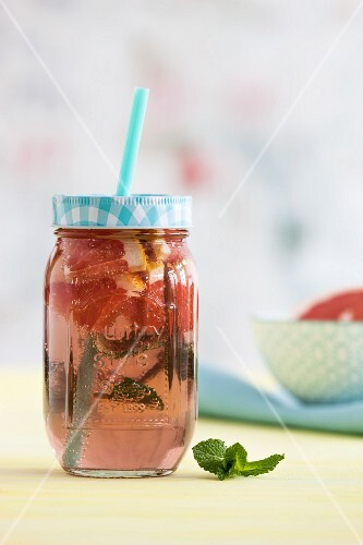 Pink grapefruit lemonade with mint in a glass jar