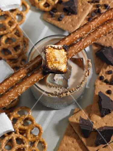 A chocolate vodka drink with marshmallows and pretzels