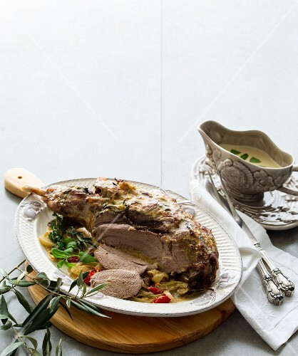 Roast leg of lamb, sliced ​​and served with sauce