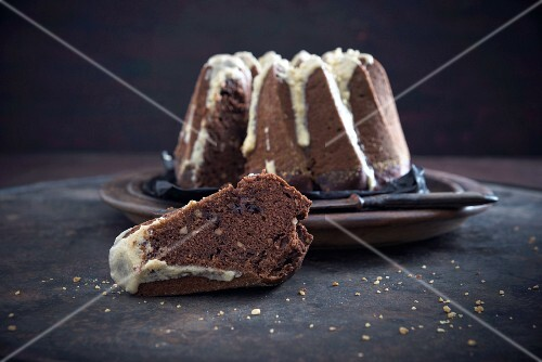A vegan chocolate and almond gugelhupf with coffee cream frosting
