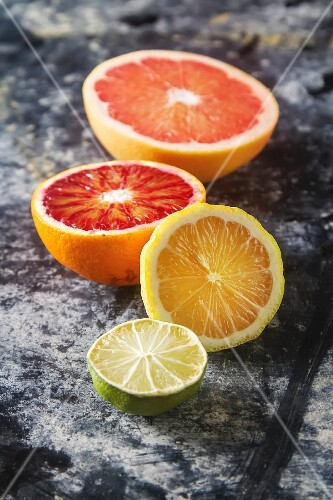 Assorted citrus fruit, halved