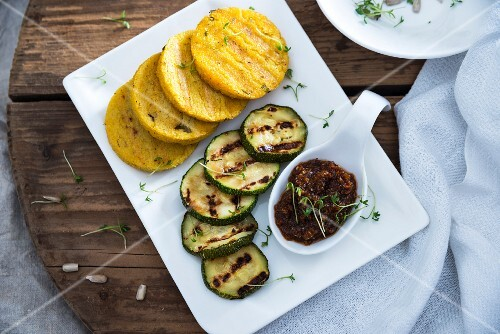 Grilled polenta and courgette slices with sunflower seed and tomato pesto (vegan)