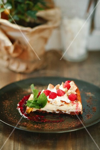 A slice of raspberry tart with fresh mint