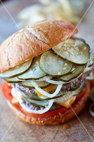 A burger with refrigerated pickles