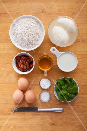Ingredients for mozzarella muffins with dried tomatoes