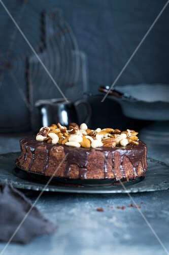 Chocolate cake topped with nuts