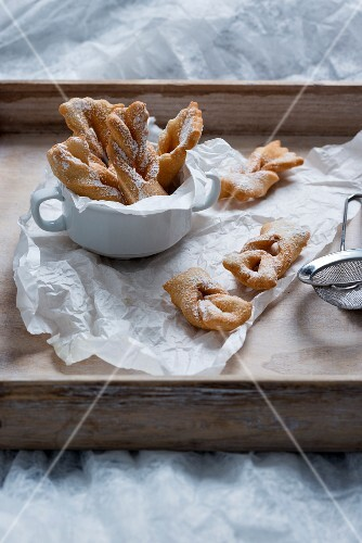 Fried vegan pastries with icing sugar