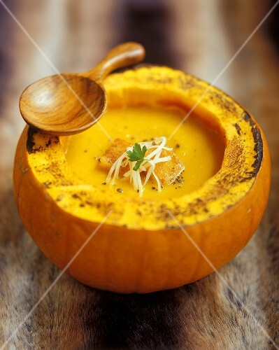 Cream of pumpkin soup in hollowed-out pumpkin