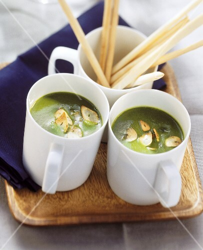 Ramsons (wild garlic) soup with garlic crisps in two cups