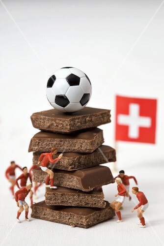 Pieces of chocolate, football, toy footballers, Swiss flag