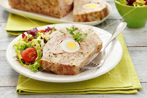 Meatloaf with egg and salad leaves