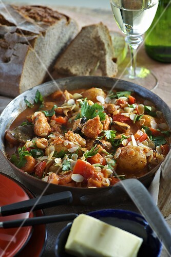 Fish and seafood ragout with potatoes and slivered almonds