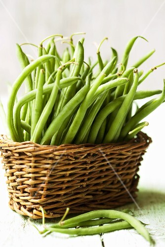 Lots of green beans in a basket