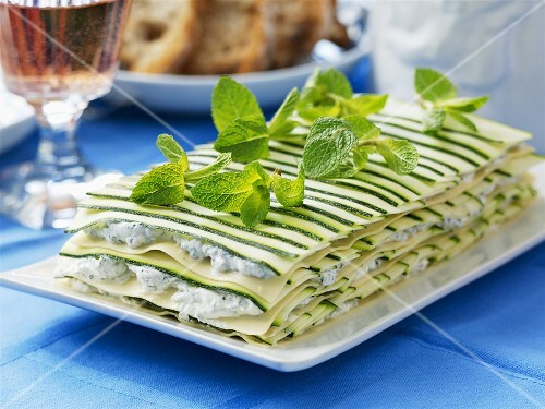 Herb soft cheese and courgette lasagne with mint leaves
