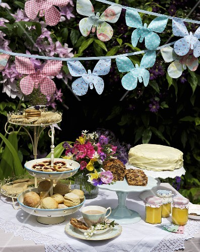Cakes, scones, biscuits etc. on a table at a garden party