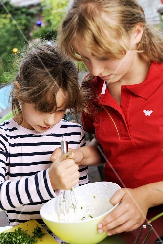 Two girls preparing chive quark