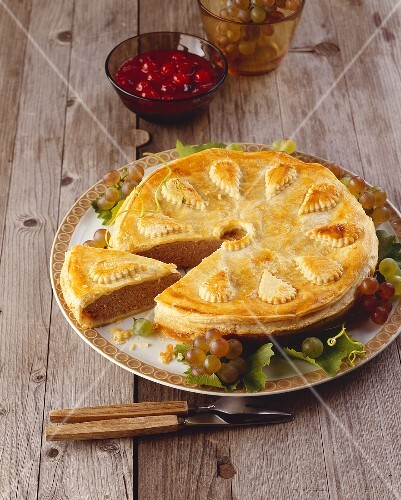 Game pie with cranberry sauce