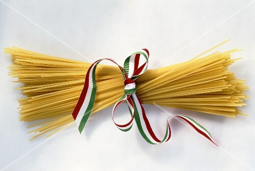 Bundle of spaghetti tied with striped ribbon