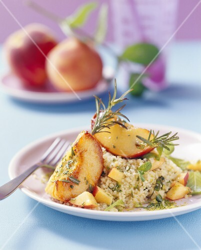 Roasted peaches with rosemary on couscous