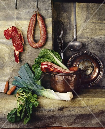 Still life with meat, sausage, vegetables and copper pot