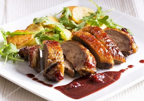 Duck breast with berry sauce and roast potatoes