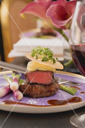 Beef fillet with potato and olive oil cream and Parmesan slices