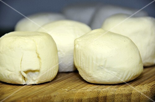 Goat's cheeses (Besace Chevre) on a chopping board