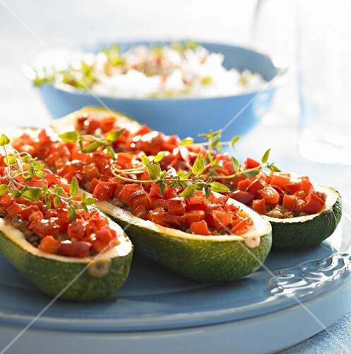 Courgettes stuffed with mince and diced tomatoes