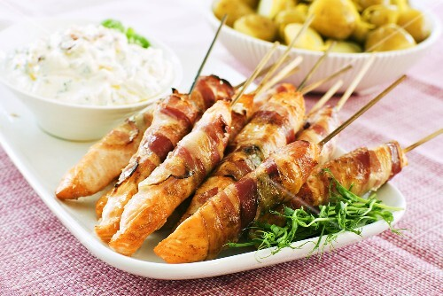 Grilled bacon-wrapped salmon skewers